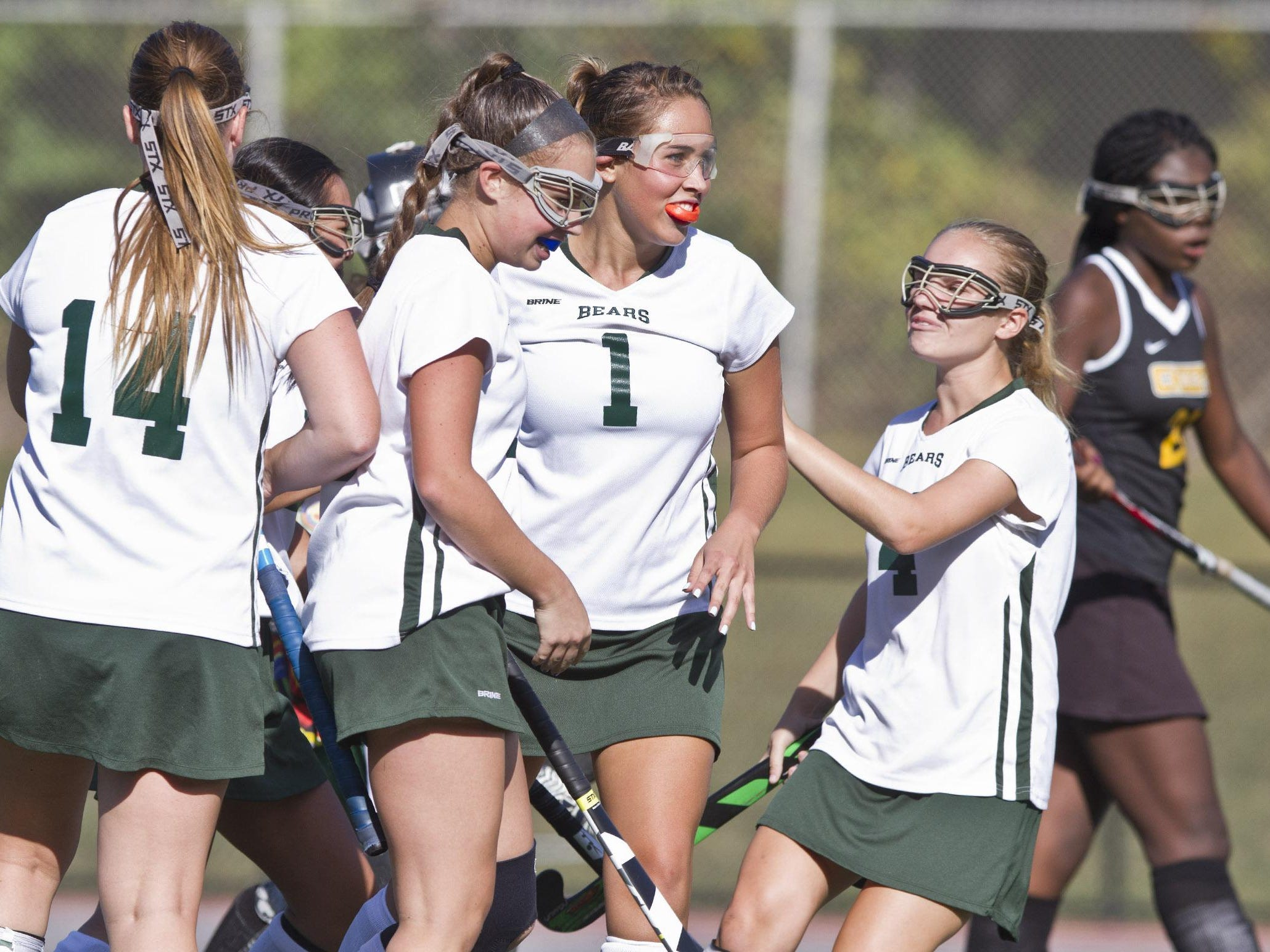 East Brunswick's Sydney Huang celebrates with teammates after scoring a goal against Piscataway on Thursday.