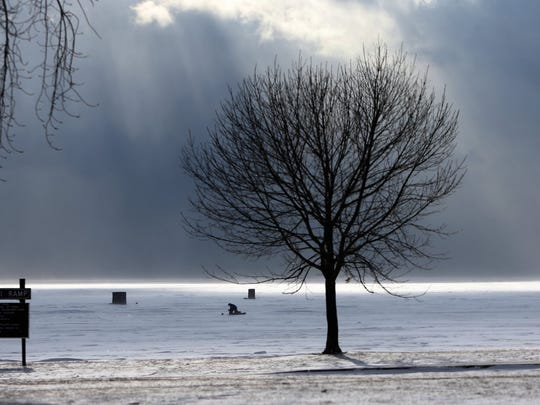 A few ice fishermen braved the cold and high winds