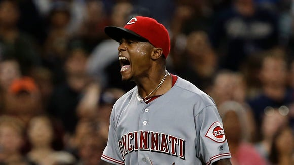 Reds relief pitcher Raisel Iglesias reacts after throwing