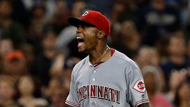 Reds relief pitcher Raisel Iglesias reacts after throwing out the Padres' Derek Norris at first base on July 30.