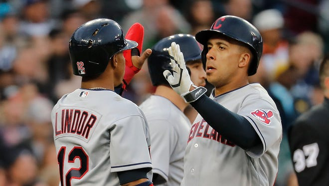 Indians' Francisco Lindor (12) and Michael Brantley celebrate scoring on a Jose Ramirez triple against the Tigers during the fourth inning in Detroit, Wednesday, May 3, 2017.