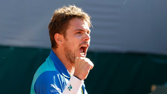 Stan Wawrinka, of Switzerland, celebrates after beating Andrey Kuznetsov of Russia, during their semifinal match at the Geneva Open.