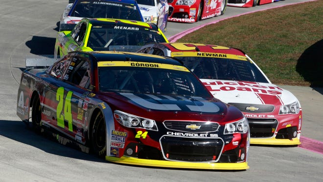 """Ryan Newman (31) battling Jeff Gordon (24) for the lead during the Oct. 2014 race, said the combination of heavy braking and Martinsville's flat surface """"just leads to more traffic jams."""""""