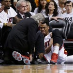Miami Heat center Hassan Whiteside (21) is attended by a team member after he was injured during the first half of Game 3.