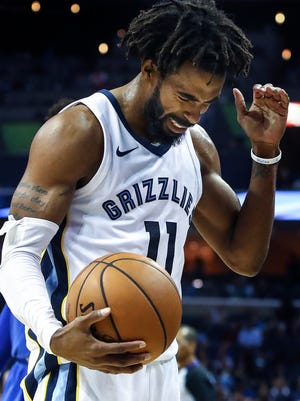 Memphis Grizzlies guard Mike Conley reacts after missing a two free throws late against the Dallas Mavericks during fourth quarter action at the FedExForum in Memphis, Tenn., Thursday, October 26, 2017.