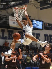 Zanesville's Cameron Brooks-Harris dunks during an overtime win against Meadowbrook at Winland Memorial Gymnasium. Brooks-Harris, a senior, was named first-team All-Ohio on Tuesday.