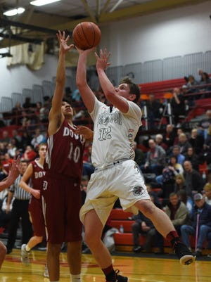 Coshocton's Devin Ryan puts up a shot against Dover.