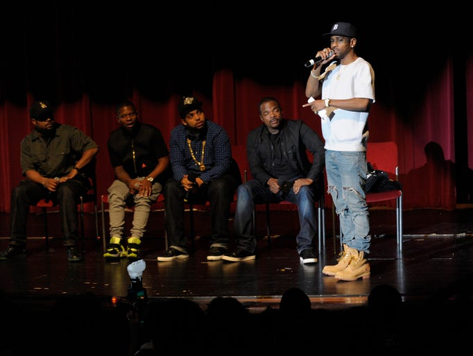 Big Sean, right, moderates a discussion at Cass Tech