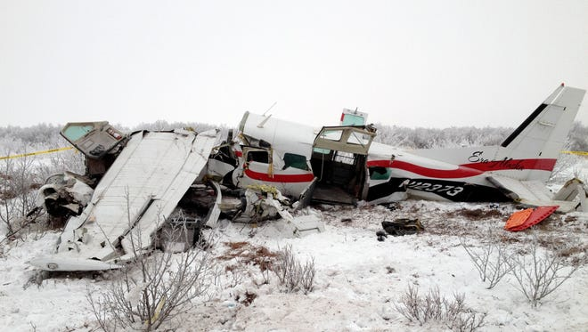 This image provided Nov. 30, 2013, by Alaska State Troopers shows the wreckage of a plane that crashed Friday near St. Marys, Alaska.