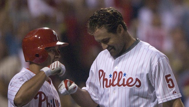 Phillies Pat Burrell is greeted at the plate after his 3 run homer by Shane Victorino in the 8th inning on Sept. 22, 2008.