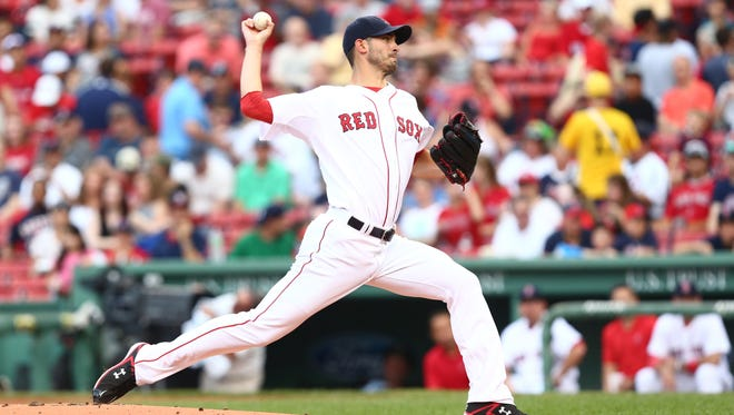 Boston Red Sox starting pitcher Rick Porcello (22) pitches against the Miami Marlins during the first inning at Fenway Park.