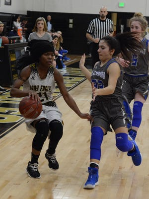 Abilene High's Trakenya Roberson tries to dribble the ball around Weatherford's Sydney Steffler while Kara Rothrock trails the play during the Lady Eagles' 37-35 loss in a District 3-6A game last season at Eagle Gym.