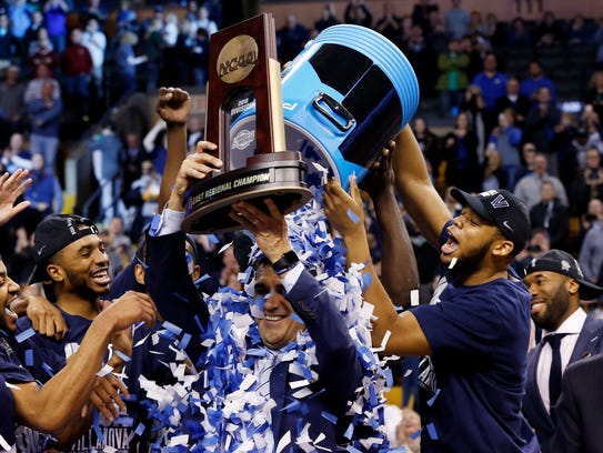 Villanova players dump confetti on coach Jay Wright