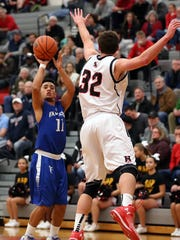 Cedar Crest senior guard Iziah Trimble shoots a 3-pointer during a regular-season game at Hempfield on Jan 21. The Falcons will need Trimble in their L-L first-round matchup at Lampeter-Strasburg on Saturday.