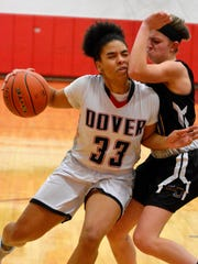 Dover's Rajah Fink catches an elbow from Jaedyn McKeon of Kennard-Dale on her way to the basket, Monday January 15, 2018. John A. Pavoncello photo