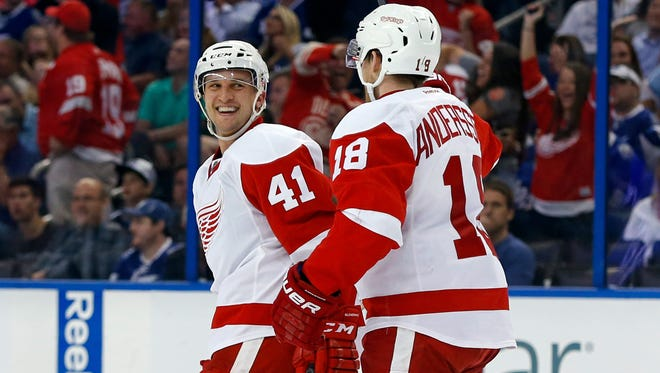 Luke Glendening, left, of the Detroit Red Wings celebrates his goal with Joakim Andersson against the Tampa Bay Lightning in Game 1 of the Eastern Conference Quarterfinals on April 16, 2015, in Tampa, Fla.