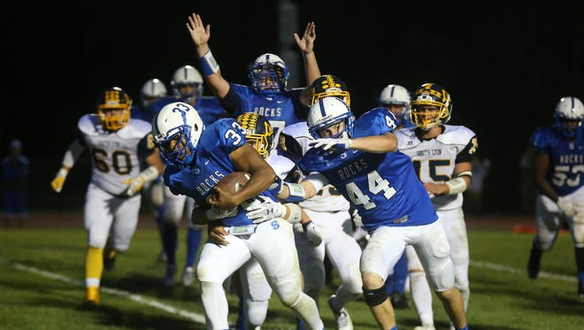 Salem's Deston Langford (left) busts into the end zone during Friday's game against South Lyon. Providing blocking help is Trevor Nowaske (right).