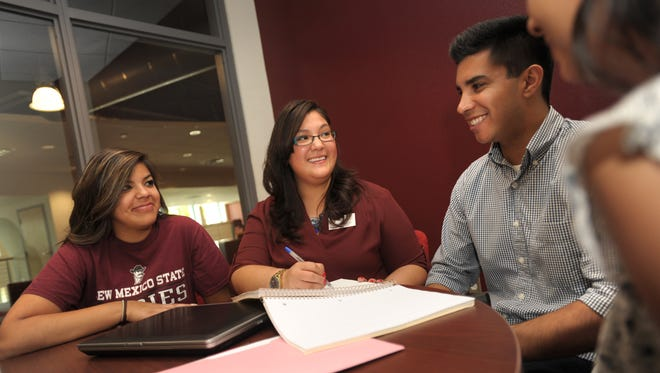 New Mexico state University cross campus advisor and Student Success Navigators program director Marissa Macias, second from left, meets with students at the Corbett Center Student Union.