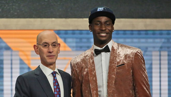 Michigan State's Jaren Jackson Jr. poses with NBA commissioner Adam Silver after he was picked fourth overall by the Memphis Grizzlies during the NBA draft in New York, Thursday, June 21, 2018.