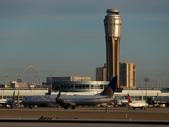 A plane takes off at McCarran International Airport on Thursday in Las Vegas. Officials at the airport said in a tweet that it will remain open with reduced operations after an air traffic controller tested positive for coronavirus late Wednesday, temporarily closing the control tower.