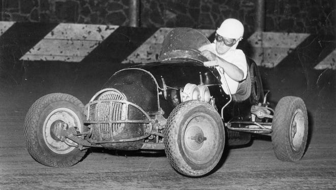 Lloyd Ruby makes his way down a dirt track in the photo capturing the famed driver in his early years.