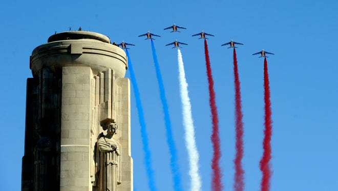 Aircraft with the Patrouille de France fly by the Liberty Memorial during the centennial of the United States entry into World War I at the National World War I Museum and Memorial in Kansas City, Missouri, on April 6, 2017.