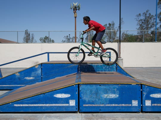 Steven Murguia gets some air on his bike at the Fritz Burns skate Park in La Quinta, Thursday, June 1, 2017.