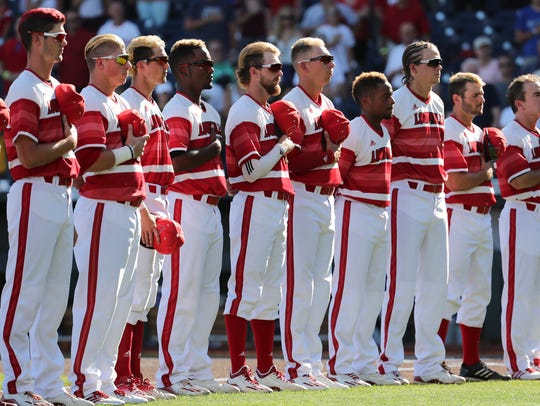 The U of L ball team during the national anthem before