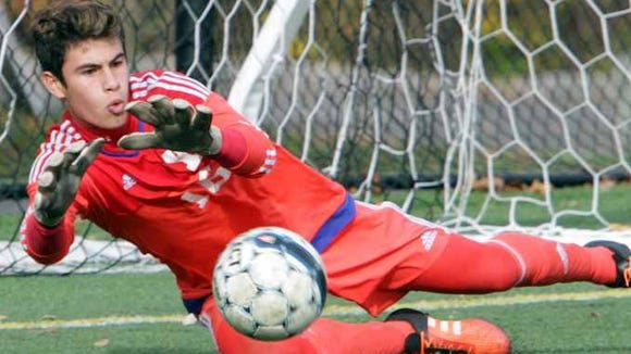 Yorktown goalie Giulino Santucci makes a save against
