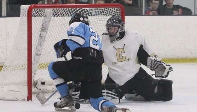 Clarkstown goalie Tim Cavanagh stops a shot in a Section 1 playoff game last February against Suffern.