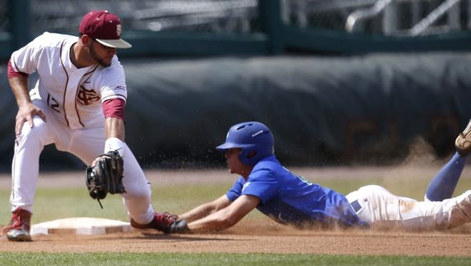FGCU's Matt Reardon slides in safely to third base under the tag of FSU's John Sansone during their game at Dick Howser Stadium on Wednesday.