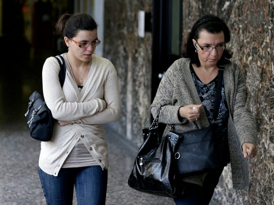 Becky Hernandez, left, daughter of Pedro Hernandez, and her mother Rosemary Hernandez leave the courtroom during a break in the trial of Pedro Hernandez in New York, Tuesday, May 5, 2015. Jurors deliberating in the murder trial of Hernandez, a man accused of kidnapping and killing 6-year-old Etan Patz in 1979, says they're deadlocked — for a second time. But a judge is telling them to keep trying for a verdict. (AP Photo/Seth Wenig)