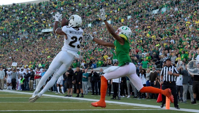Sep 24, 2016; Eugene, OR, USA; Colorado defensive back Ahkello Witherspoon (23) intercepts the ball against Oregon wide receiver Darren Carrington II (7) at Autzen Stadium, sealing the Buffaloes victory. Mandatory Credit: Scott Olmos-USA TODAY Sports
