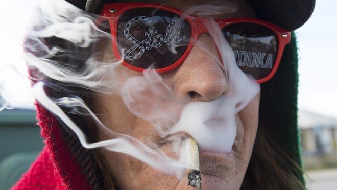 Bill Semeniuk, 67, smokes cannabis in Kamloops, British Columbia, Wednesday, Oct. 17, 2018.