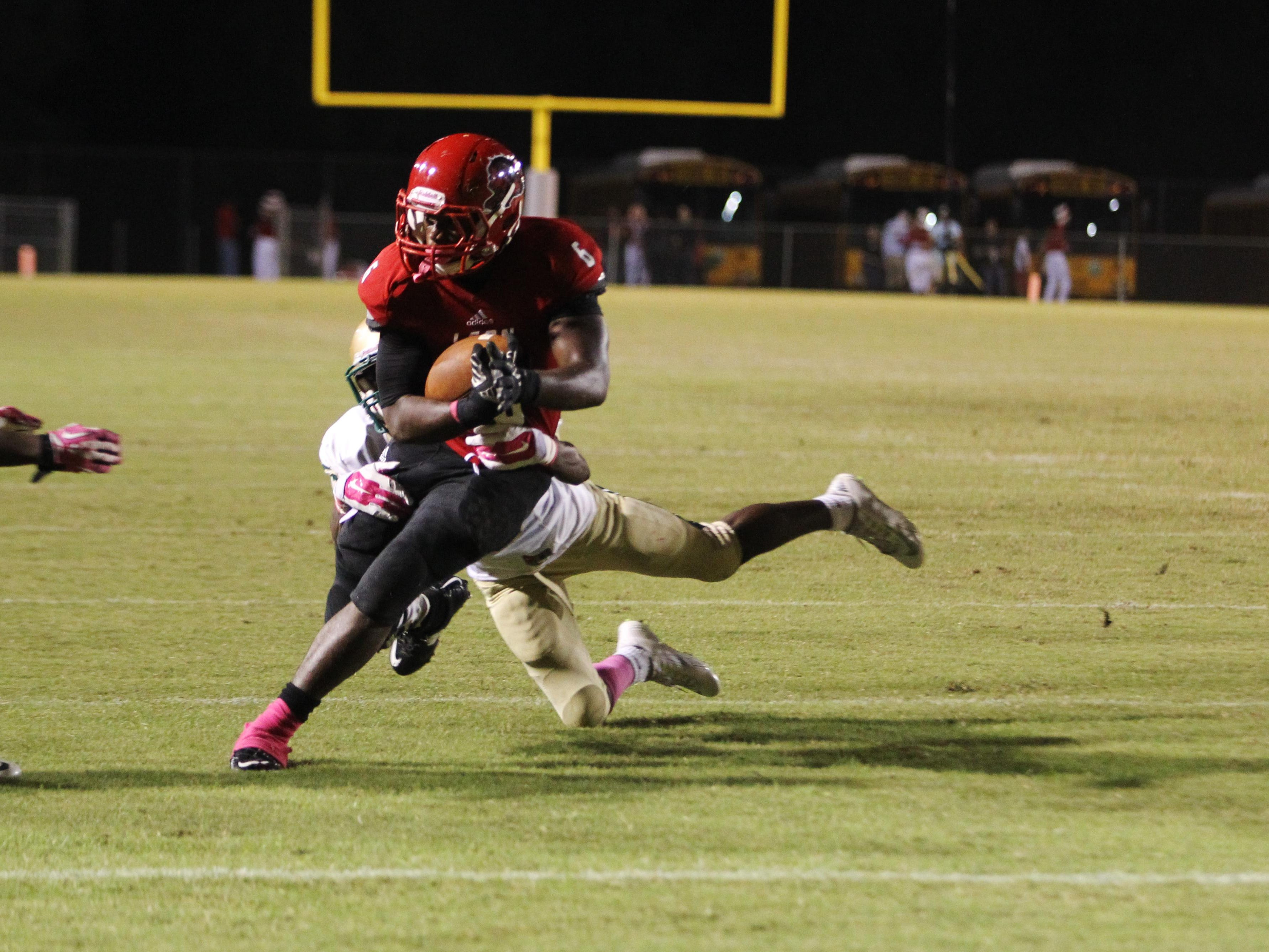 Leon High running back Sam Thomas tries to avoid Lincoln High defenders. Leon and Lincoln competed on Oct. 16, 2015, at Gene Cox Stadium. Lincoln was up 21-7 by the fourth quarter.