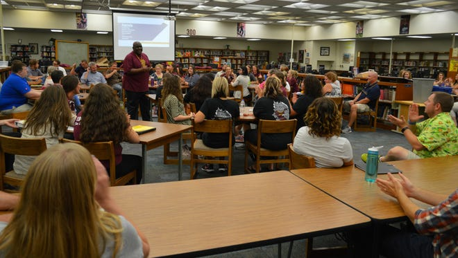Staff members gather for a Community Circle at Central High School.