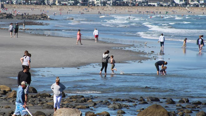 Plenty of people flocked to Long Sands Beach in York, Maine, on Sunday, June 14, 2020, during the first weekend when sunbathing has been allowed since the COVID-19 pandemic restrictions took effect. They mostly kept their distance from one another.
