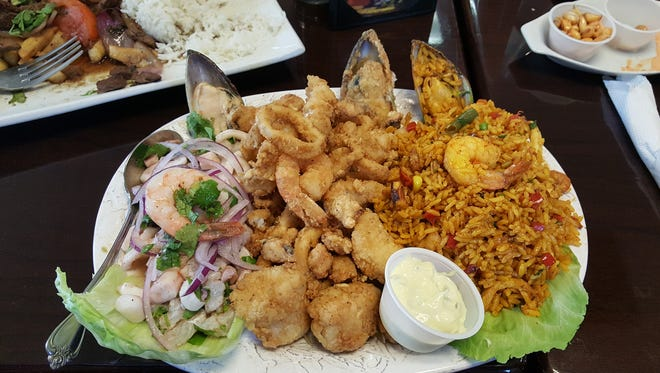 """The """"small"""" version of tres mares dish at Aji Limon comes with ceviche, from left, jalea and paella."""
