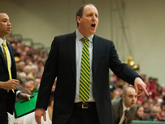 University of Vermont men's basketball coach head coach John Becker talks to his team during the America East Conference tournament semifinals vs. Stony Brook last year.