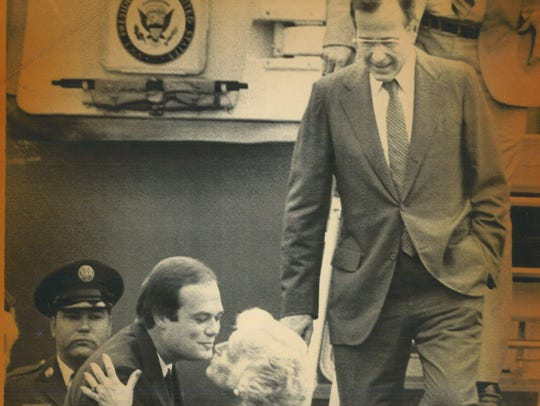 U.S. Rep. Tom Tauke kisses Barbara Bush as her husband,