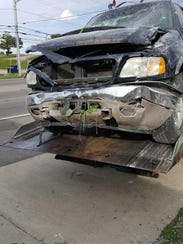 The front of the Ford Expedition following the crash.