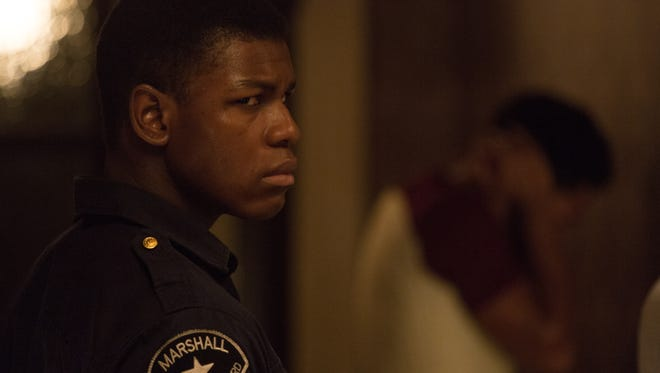 """John Boyega plays a security guard caught up in police brutality during the Motor City's 1967 riots in """"Detroit."""""""