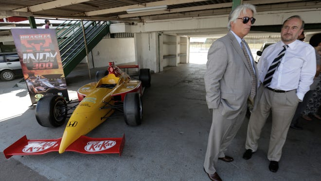 Mark Miles, CEO of Hulman & Co, left, talks to Willy Herrmann, representative of IndyCar in Brazil, before a press conference to launch the Formula Indy at the Nelson Piquet Autodromo in Brasilia, Brazil, Thursday, Sept. 18, 2014. IndyCar's long-expected return to Brazil has been confirmed.