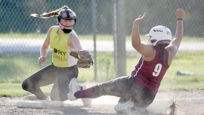 Custom Weatherproofing's Alexis Trigg attempts to slide under the tag by Moberly Glory third baseman in the second inning Monday night in Babe Ruth 16Usoftball at Rolling Hills park.