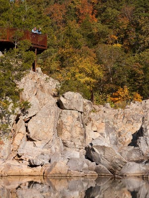 Visitors look down at the water at Johnson's Shut-Ins State Park.