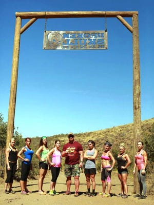 Kristen Bartiss stands to the right of Steve Austin as she gathers with other elite athletes at the Broken Skull Ranch in Texas for the Broken Skull Challenge.