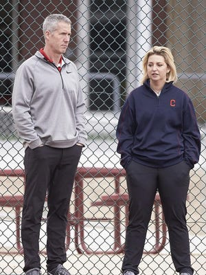 Indians vice president of learning and development for baseball operations Jay Hennessey watches players with performance coach Ceci Clark.