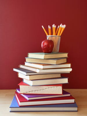 School Books with Apple and Pencils on Top
