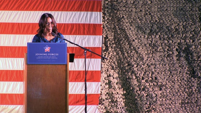 First Lady Michelle Obama speaks to US soldiers at Qatar's Al-Udeid military air base  in Doha on Tuesday.