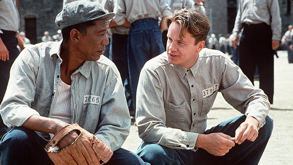 Morgan Freeman, left, and Tim Robbins make the most of their jail time in 'The Shawshank Redemption.'